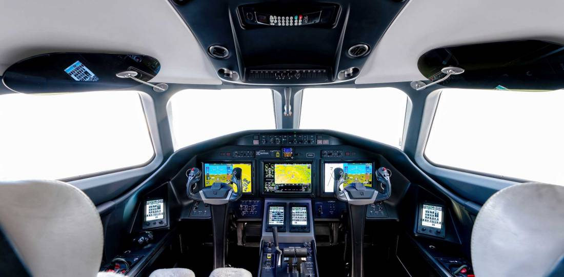 The Longitude's spacious flight deck features Garmin's G5000 avionics suite with four touchscreen controllers.